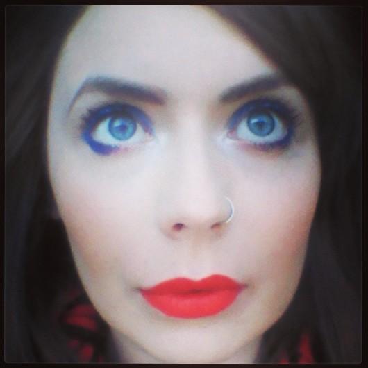 Eyes: Rimmel Scandaleyes in Bright Blue Lips: MAC Lady Danger Cheeks: MAC Peaches
